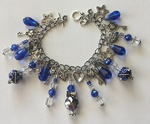 In Honor of Luken - Blue Charm Bracelet - Caris Roane Paranormal Romance Author